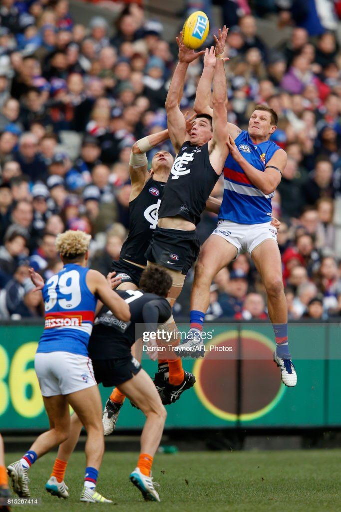 Matthew Kreuzer of the Blues and Jack Redpath of the Bulldogs compete for the ball during the round 17 AFL match between the Carlton Blues and the Western Bulldogs at Melbourne Cricket Ground on July 16, 2017 in Melbourne, Australia.