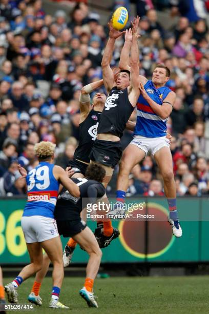 Matthew Kreuzer of the Blues and Jack Redpath of the Bulldogs compete for the ball during the round 17 AFL match between the Carlton Blues and the...