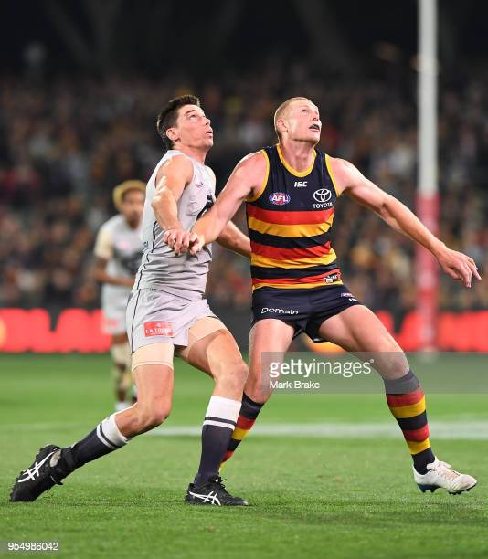 Matthew Kreuzer of the Blues and Sam Jacobs of the Adelaide Crows compete for a throw in during the round seven AFL match between the Adelaide Crows...