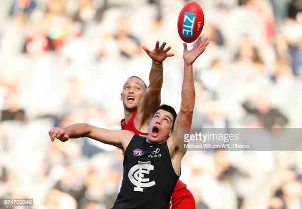 Matthew Kreuzer of the Blues and Sam Reid of the Swans compete in a ruck contest during the 2017 AFL round 06 match between the Carlton Blues and the...