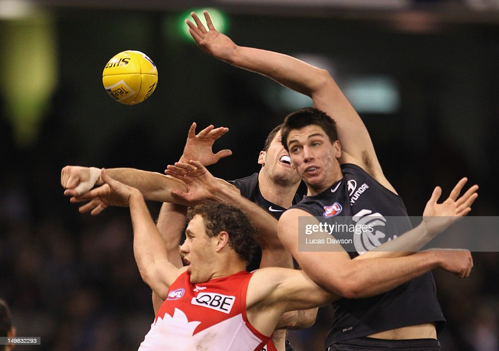 Matthew Kreuzer of the Blues and Shane Mumford of the Swans contest for a mark during the round 19 AFL match between the Carlton Blues and the Sydney Swans at Etihad Stadium on August 5, 2012 in Melbourne, Australia.