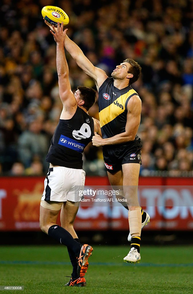 Matthew Kreuzer of the Blues and Shaun Hampson of the Tigers compete in a ruck contest during the 2015 AFL round 15 match between the Richmond Tigers and the Carlton Blues at the Melbourne Cricket Ground, Melbourne, Australia on July 10, 2015.