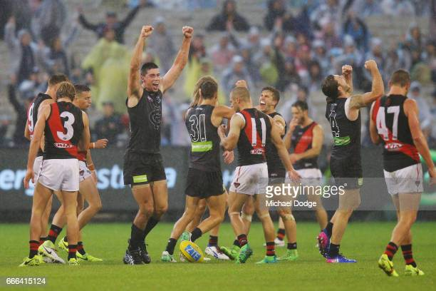 Matthew Kreuzer of the Blues celebrates winning on the final siren with Marc Murphy and Bryce Gibbs during the round three AFL match between the...