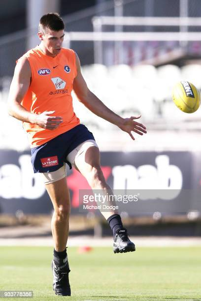 Matthew Kreuzer of the Blues kicks the ball during a Carlton Blues AFL training session at Ikon Park on March 19 2018 in Melbourne Australia
