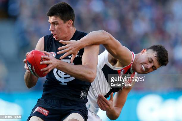Matthew Kreuzer of the Blues marks in front of Rowan Marshall of the Saints during the round 22 AFL match between the Carlton Blues and the St Kilda...