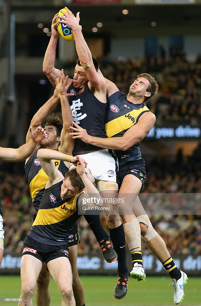Matthew Kreuzer of the Blues marks infront of Shaun Hampson of the Tigers during the round 15 AFL match between the Richmond Tigers and the Carlton Blues at Melbourne Cricket Ground on July 10, 2015 in Melbourne, Australia.
