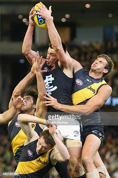 Matthew Kreuzer of the Blues marks infront of Shaun Hampson of the Tigers during the round 15 AFL match between the Richmond Tigers and the Carlton...