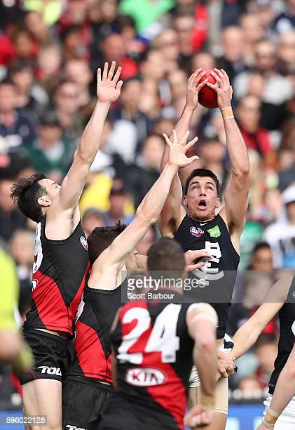 Matthew Kreuzer of the Blues takes a mark during the round 23 AFL match between the Essendon Bombers and the Carlton Blues at Melbourne Cricket...