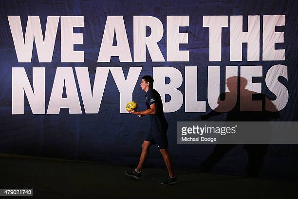 Matthew Kreuzer of the Blues walks up to the ground before warm up during the round one AFL match between the Carlton Blues v Port Adelaide Power at...