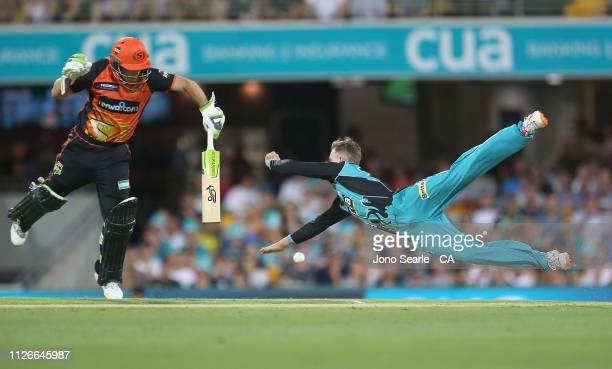 Matthew Kuhnemann of the Heat dives for the ball during the Big Bash League match between the Brisbane Heat and the Perth Scorchers at The Gabba on...