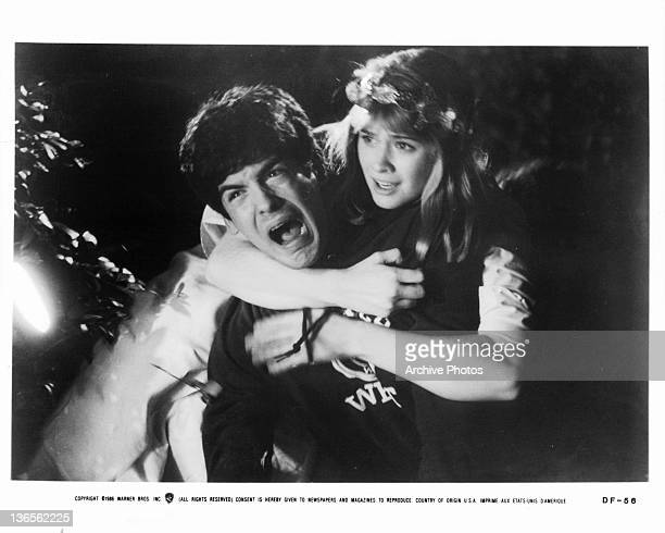 Matthew Labyorteaux is clutched by Kristy Swanson in a scene from the film 'Deadly Friend', 1986.