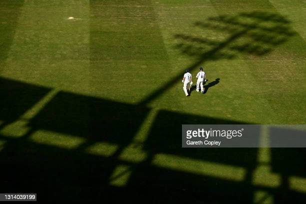 Matthew Lamb and Olly Stone of Warwickshire walk out for the 3rd session during the LV= Insurance County Championship match between Warwickshire and...