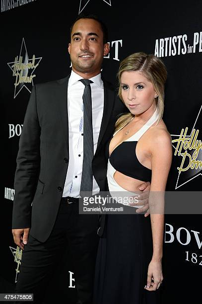 Matthew Lamothe and Lindsay Lamb attend the 7th Annual Hollywood Domino and Bovet 1822 Gala benefiting artists for peace and justice at Sunset Tower...
