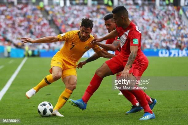 Matthew Leckie of Australia battles for the ball with Miguel Trauco and Anderson Santamaria during the 2018 FIFA World Cup Russia group C match...