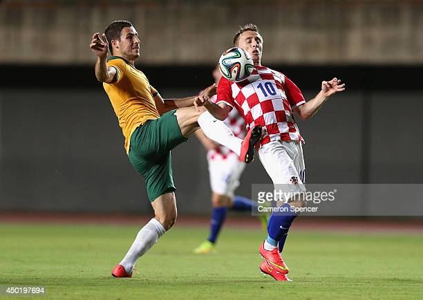 Matthew Leckie of the Socceroos and Luka Modric of Croatia contest the ball during the International Friendly match between Croatia and the...