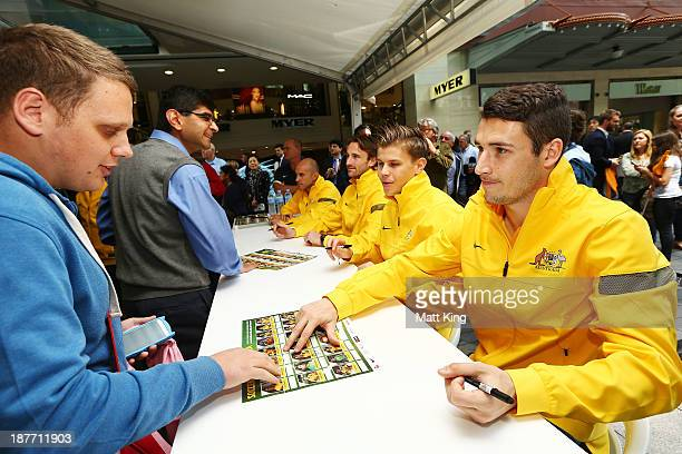 Matthew Leckie signs autographs for fans during an Australian Socceroos public appearance at Westfield Sydney on November 12 2013 in Sydney Australia