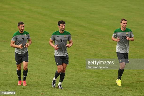 Matthew Leckie Socceroos captain Mile Jedinak and Alex Wilkinson of the Socceroos run during an Australian Socceroos training session at Arena Unimed...