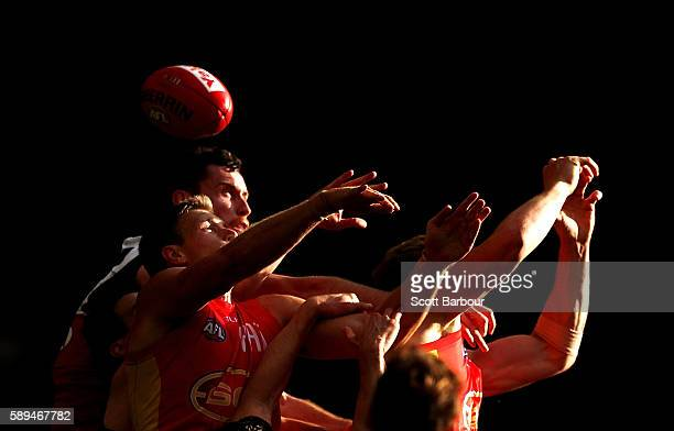 Matthew Leuenberger of the Bombers and Tom Lynch of the Suns compete for the ball during the round 21 AFL match between the Essendon Bombers and the...