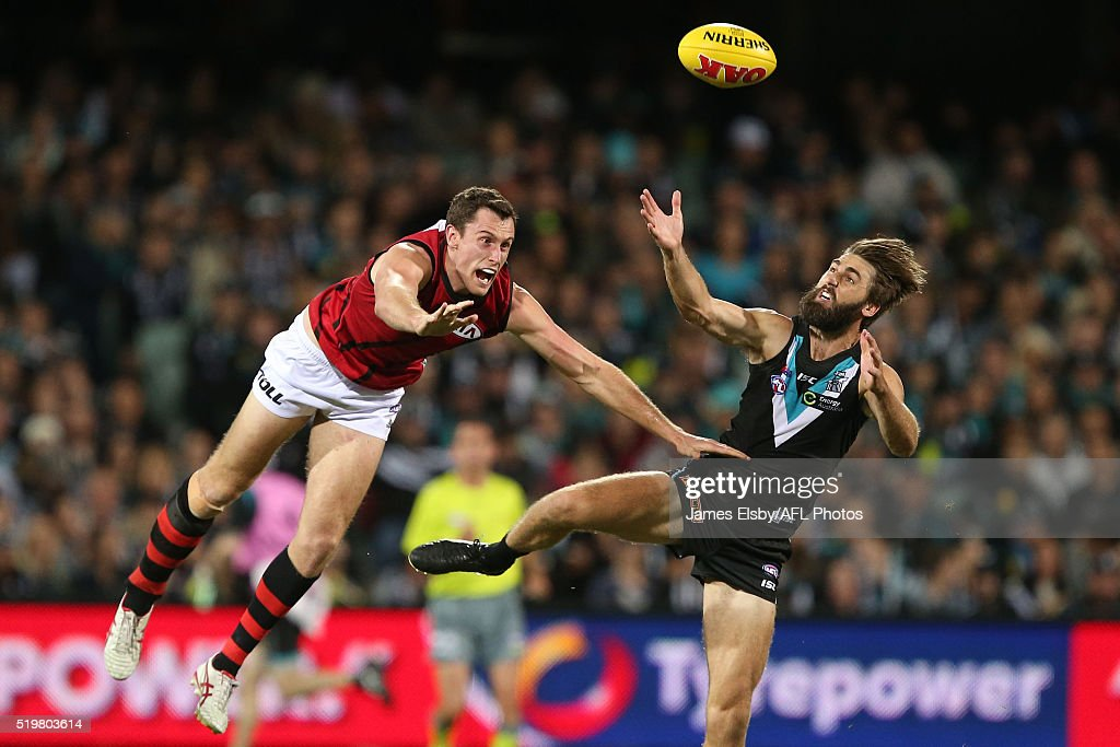 Matthew Leuenberger of the Bombers clashes with Justin Westhoff of the Power during the 2016 AFL Round 03 match between Port Adelaide Power and the Essendon Bombers at the Adelaide Oval, Adelaide on April 8, 2016.