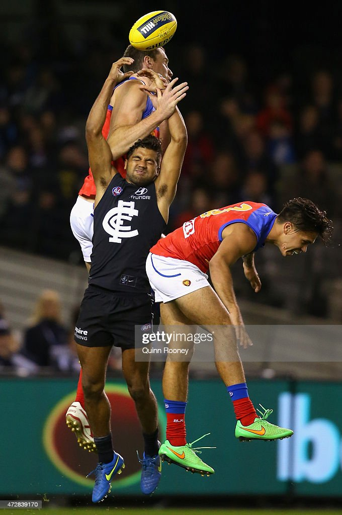 Matthew Leuenberger of the Lions and Clem Smith of the Blues compete for a mark during the round six AFL match between the Carlton Blues and the Brisbane Lions at Etihad Stadium on May 10, 2015 in Melbourne, Australia.