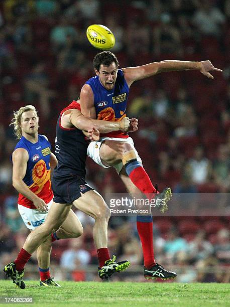 Matthew Leuenberger of the Lions kicks under pressure during the round 17 AFL match between the Melbourne Demons and the Brisbane Lions at TIO...