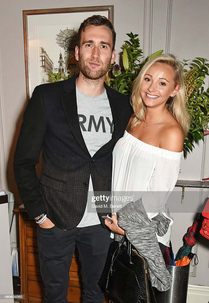 Matthew Lewis (L) and Lauren Hickford attends an after party following the press night performance of 'The Mentalists' at Kettner's on July 13, 2015 in London, England.