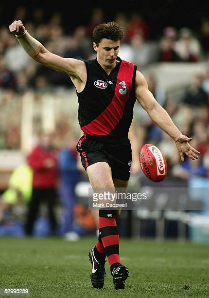 Matthew Lloyd for the Bombers kicks for goal during the AFL Round 10 match between the Essendon Bombers and the Western Bulldogs at Telstra Dome May...