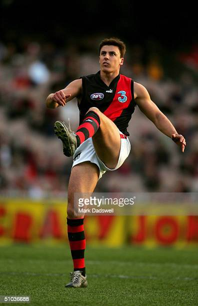 Matthew Lloyd of the Bombers kicks for goal during the round 11 AFL match between the Hawthorn Hawks and the Essendon Bombers at the Melbourne...