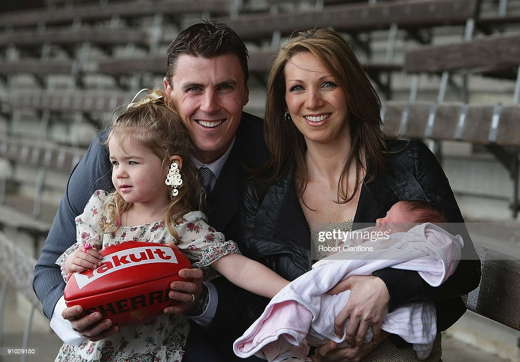 Matthew Lloyd of the Bombers poses with his wife Lisa, and duaghters, Jaeda and Kira after announcing his retirememnt from AFL football at Windy Hill on September 23, 2009 in Melbourne, Australia.