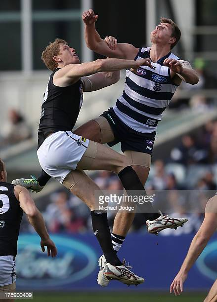Matthew Lobbe of Port Adelaide and Nathan Vardy of the Cats contest for the ball during the round 20 AFL match between the Geelong Cats and Port...