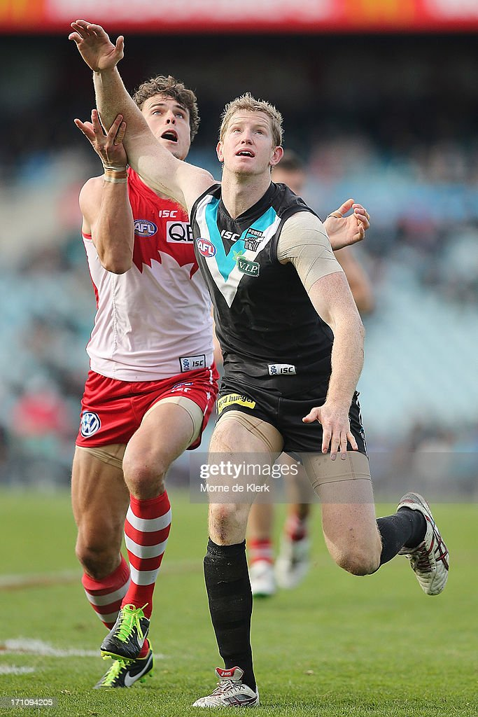 Matthew Lobbe of the Power competes in the ruck with Mike Pyke of the Swans during the round 13 AFL match between Port Adelaide Power and the Sydney Swans at AAMI Stadium on June 22, 2013 in Adelaide, Australia.