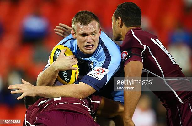 Matthew Lodge of NSW is tackled during the U20s State of Origin match between New South Wales and Queensland at Centrebet Stadium on April 20, 2013...
