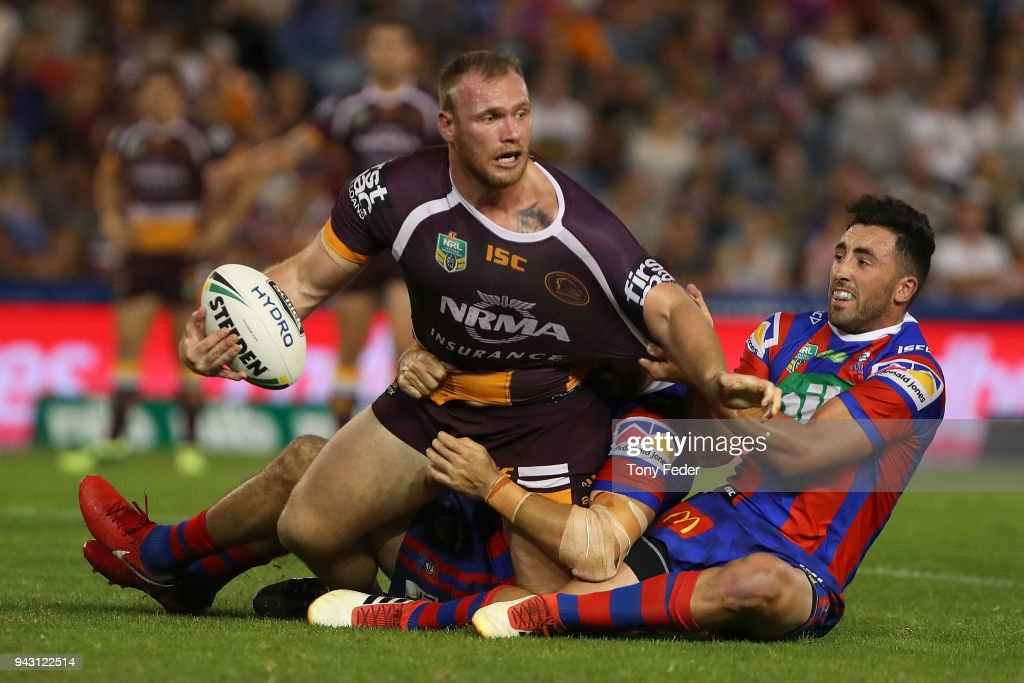 Matthew Lodge of the Broncos is tackled by Brock Lamb of the Knights during the round five NRL match between the Newcastle Knights and the Brisbane Broncos at McDonald Jones Stadium on April 7, 2018 in Newcastle, Australia.