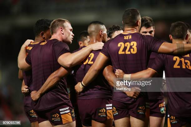 Matthew Lodge of the Broncos stands in a huddle with team mates before the round one NRL match between the St George Illawarra Dragons and the...