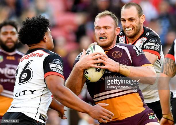 Matthew Lodge of the Broncos takes on the defence during the round 18 NRL match between the Brisbane Broncos and the New Zealand Warriors at Suncorp...