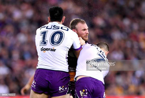 Matthew Lodge of the Broncos takes on the defence during the round seven NRL match between the Brisbane Broncos and the Melbourne Storm at Suncorp...