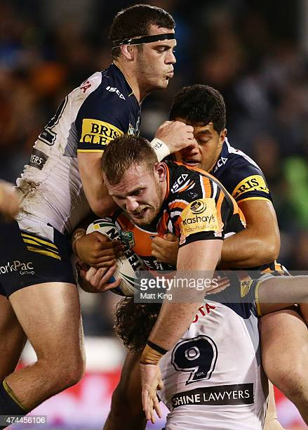Matthew Lodge of the Tigers is tackled during the round 11 NRL match between the Wests Tigers and the North Queensland Cowboys at Campbelltown Sports...