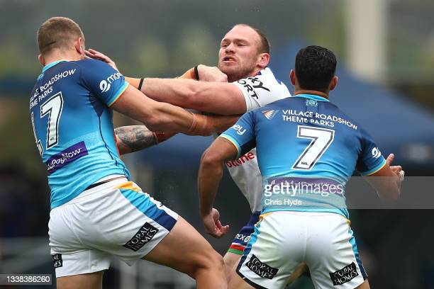Matthew Lodge of the Warriors is tackled during the round 25 NRL match between the Gold Coast Titans and the New Zealand Warriors at Cbus Super...