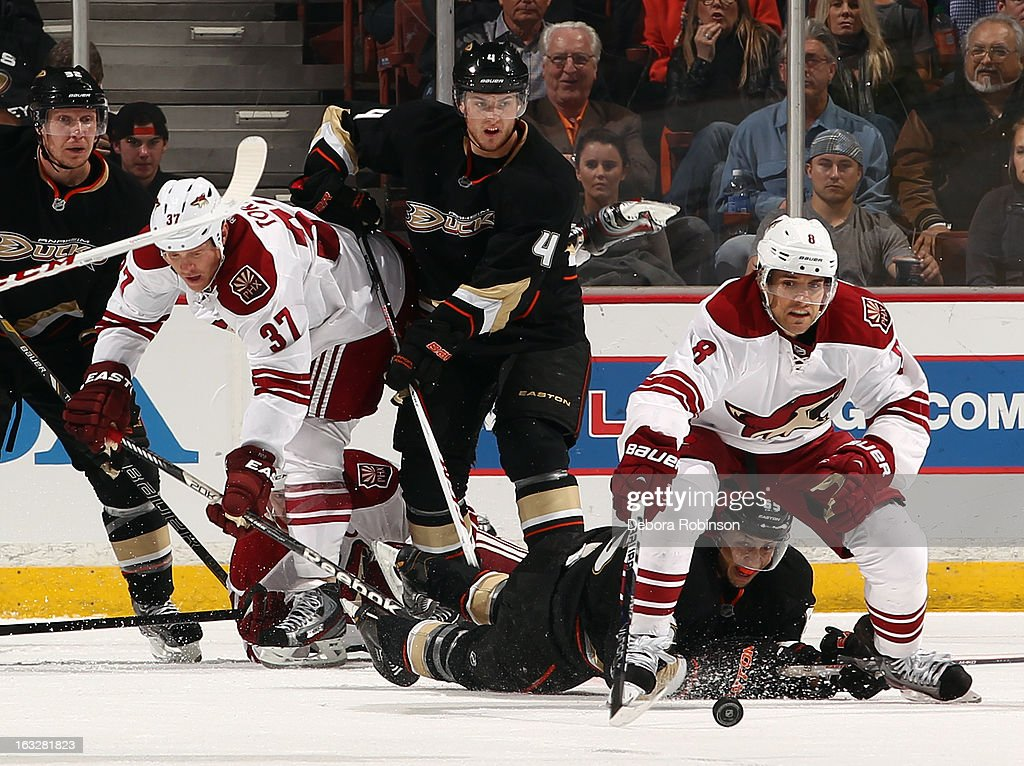 Matthew Lombardi #8 and Raffi Torres #37 of the Phoenix Coyotes battle for the puck against Cam Fowler #4 and Emerson Etem #65 of the Anaheim Ducks on March 6, 2013 at Honda Center in Anaheim, California.