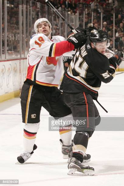 Matthew Lombardi of the Calgary Flames battles for position against Bobby Ryan of the Anaheim Ducks during the game on February 11 2009 at Honda...