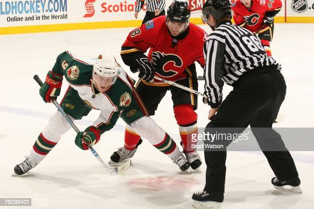 Matthew Lombardi of the Calgary Flames skates against Mikko Koivu of the Minnesota Wild on January 22, 2008 at Pengrowth Saddledome in Calgary,...