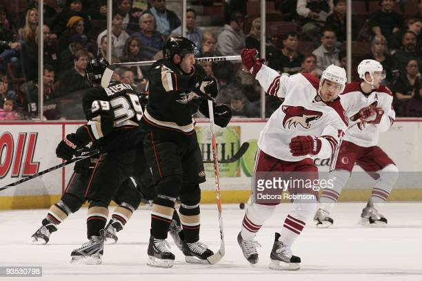 Matthew Lombardi of the Phoenix Coyotes hits Ryan Whitney of the Anaheim Ducks in the head with the stick during the game on November 29 2009 at...