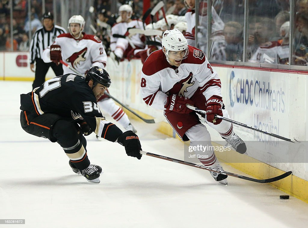 Matthew Lombardi #8 of the Phoenix Coyotes is pursued by Daniel Winnik #34 of the Anaheim Ducks for the puck in the second period at Honda Center on March 6, 2013 in Anaheim, California. The Ducks defeated the Coyotes 2-0.