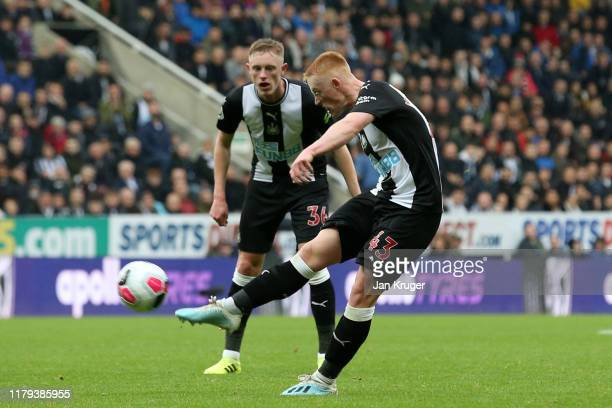 Matthew Longstaff of Newcastle United takes a shot which hits the crossbar during the Premier League match between Newcastle United and Manchester...