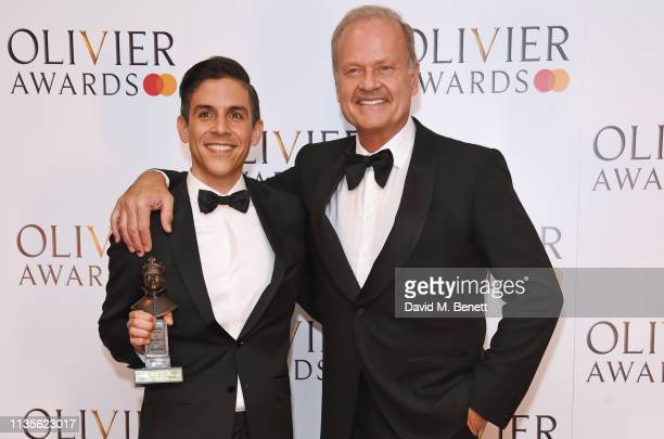 Matthew Lopez accepting the Best New Play award for 'The Inheritance' and Kelsey Grammer pose in the press room at The Olivier Awards 2019 with...