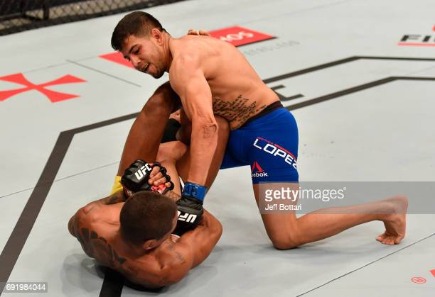 Matthew Lopez punches Johnny Eduardo of Brazil in their bantamweight bout during the UFC 212 event at Jeunesse Arena on June 3 2017 in Rio de Janeiro...