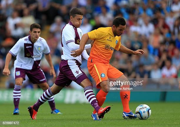 Matthew Lowton of Aston Villa and Sam Wood of Wycombe Wanderers