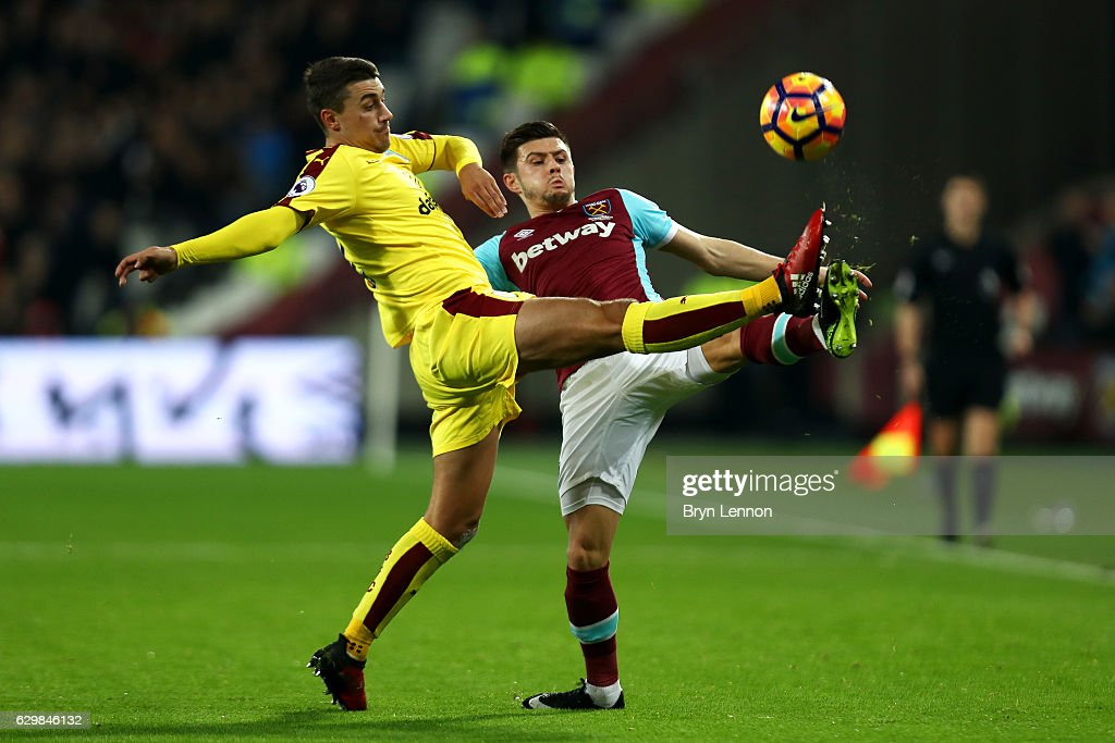 Matthew Lowton of Burnley (L) and Aaron Cresswell of West Ham United (R) battle for possession during the Premier League match between West Ham United and Burnley at London Stadium on December 14, 2016 in Stratford, England.