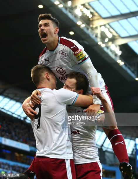 Matthew Lowton of Burnley celebrates with Ashley Barnes after he scored his sides first goal during the The Emirates FA Cup Third Round match between...