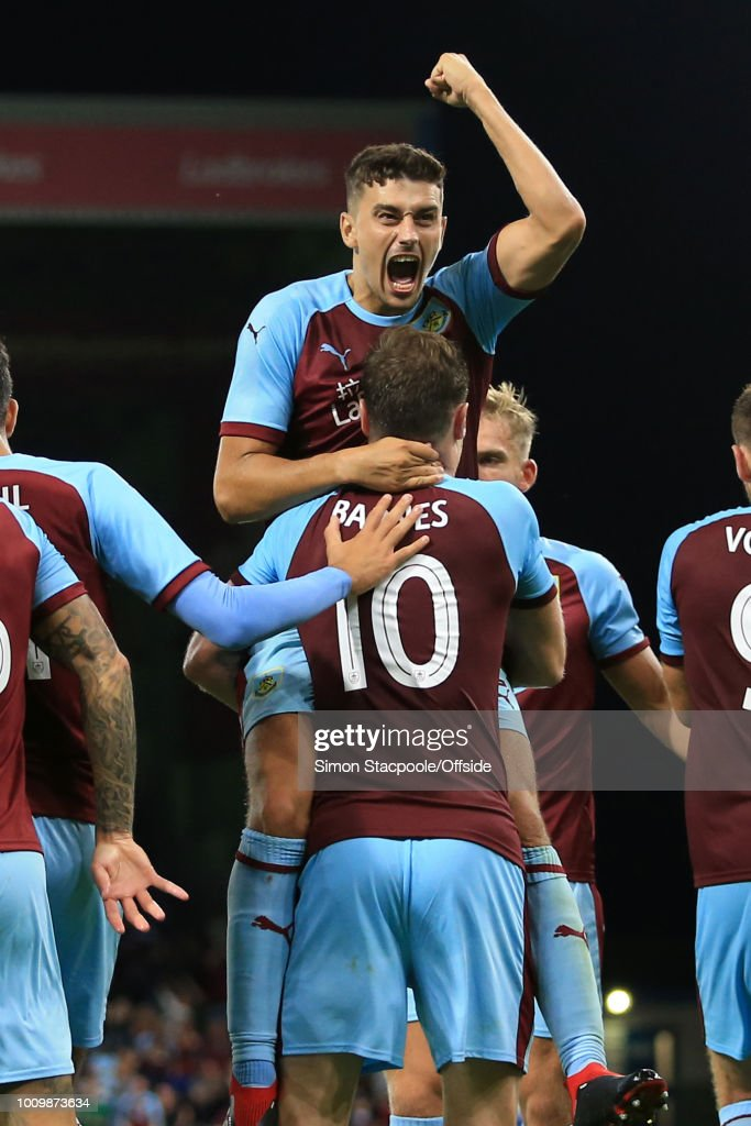 Matthew Lowton of Burnley celebrates with goalscorer Ashley Barnes of Burnley (10) after he scored their 3rd goal during the UEFA Europa League Second Qualifying Round 2nd Leg match between Burnley and Aberdeen at Turf Moor on August 2, 2018 in Burnley, England.